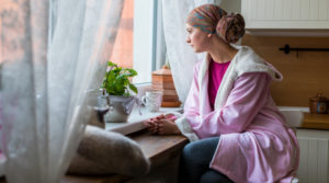 Oncology Patient Sits by a window